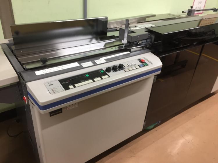 マーブル貼り機(印刷製本部)